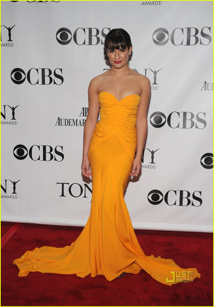 In mustard-yellow marmaid-style by Zac Posen