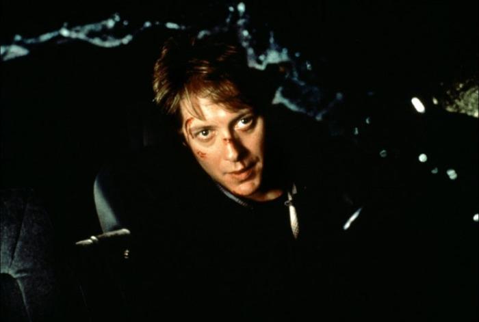 James Spader è Ballard: Il producer cinematografico che a seguito di un Crash automobilistico sviluppa un'insana pulsione sadomasochistica per la carrozzeria (1996).