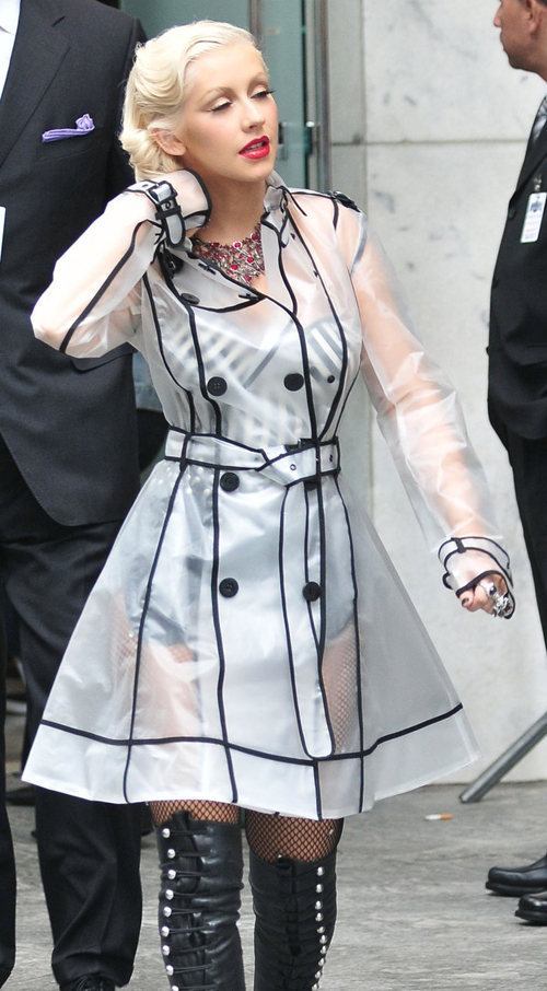 Christina Aguilera in black-trimmed PVC trench coat