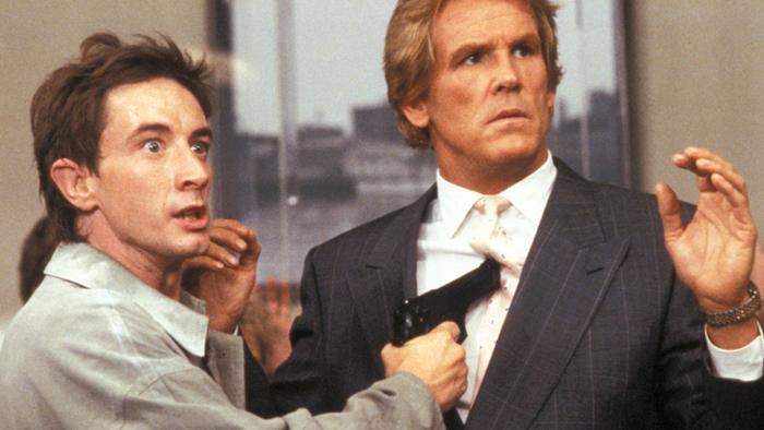 Il maldestro rapinatore di banche Martin Short e l'ostaggio Nick Nolte In Fuga per Tre (1989)