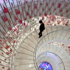 The main staircase in the House of Barbie displays an overwhelming number of Barbies all dressed in pink