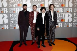 The 1975 in paisley print suits