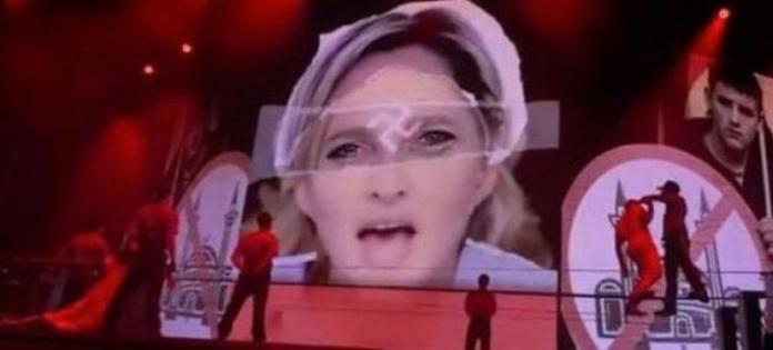 Sceglie i simboli nazisti per criticare la politica reazionaria di Marine Le Pen nella tappa di Tel Aviv del MDNA tour. La leader francese minaccia allora di denunciare la cantante se proietterà quelle immagini nella tappa di Parigi. 2012