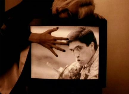 Sottomessa dal matador nel video Take a Bow, 1994